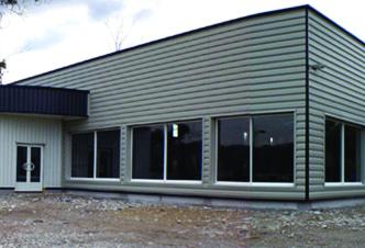 construction bâtiment clef en main commercial metallique façade bardage